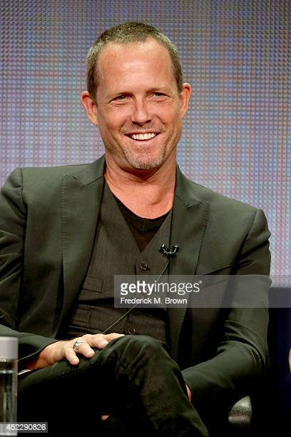 Actor Dean Winters speaks onstage at the Battle Creek panel during the CBS Network portion of the 2014 Summer Television Critics Association at The...
