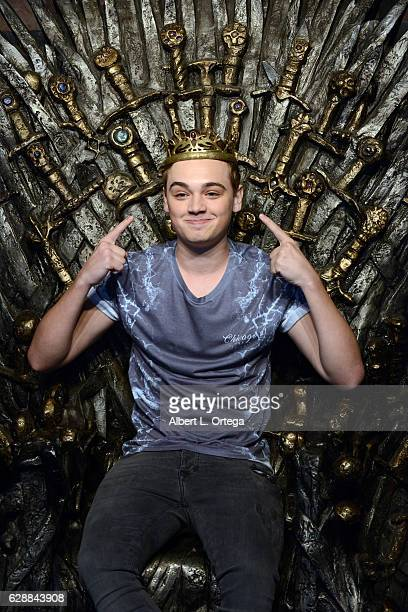 Actor DeanCharles Chapman sits atop the Iron Throne of Westros at HBO's Game Of Thrones Season 6 Behind The Scenes Fan Event held at Hollywood...