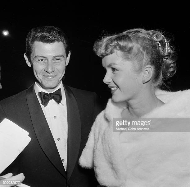 """Actor Debbie Reynolds and Eddie Fisher attend the movie premiere of """"Ten Commandments"""" in Los Angeles,CA"""