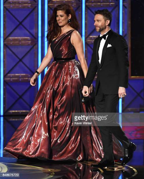 Actor Debra Messing and TV personality Chris Hardwick walk onstage during the 69th Annual Primetime Emmy Awards at Microsoft Theater on September 17...