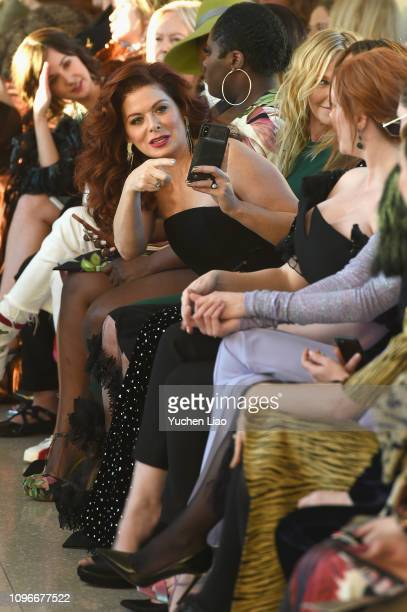 Actor Debra Messing attends the Christian Siriano front row during New York Fashion Week The Shows at Top of the Rock on February 9 2019 in New York...