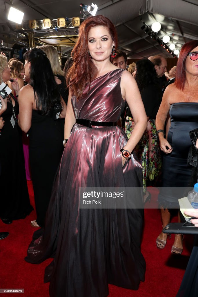 Actor Debra Messing walks the red carpet during the 69th Annual Primetime Emmy Awards at Microsoft Theater on September 17, 2017 in Los Angeles, California.