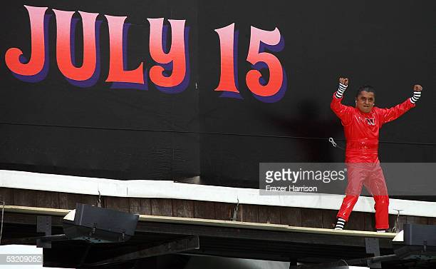 Actor Deep Roy who plays an Oompa Loompa in Charlie and the Chocolate Factory dances on the movie billboard ahead of the upcoming July 15 movie...