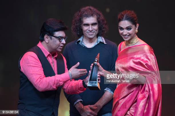 Actor Deepika Padukone receives the Indias Most Stylish award from director Imtiaz Ali and Rajan Bhalla Group CMO Ht Media during Hindustan Times...