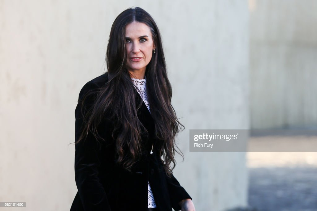 Actor Demi Moore attends the Christian Dior Cruise 2018 Runway Show at the Upper Las Virgenes Canyon Open Space Preserve on May 11, 2017 in Santa Monica, California.