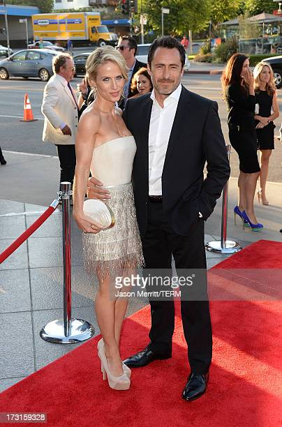 Actor Demian Bichir and his wife Lisset Gutierrez arrive at the series premiere of FX's 'The Bridge' at the DGA Theater on July 8 2013 in Los Angeles...