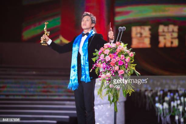 Actor Deng Chao wins the Best Actor award of the Golden Rooster Awards during the closing ceremony of the 26th China Golden Rooster and Hundred...