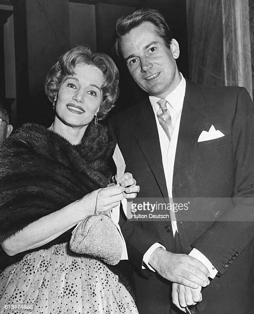 Actor Denholm Elliot and actress Constance Cummings arriving at the Royal Opera House for the last night of Antigone London 1959