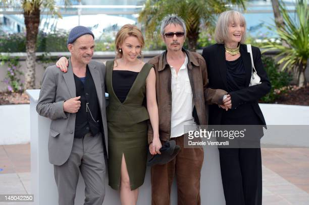 Actor Denis Lavant actress and singer Kylie Minogue director Leos Carax and french actress Edith Scob attend the Holy Motors Photocall during the...