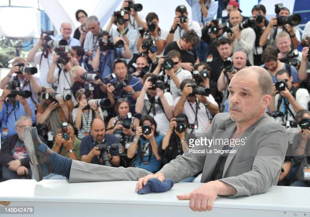 Actor Denis Lavant poses at the Holy Motors Photocall during the 65th Annual Cannes Film Festival at Palais des Festivals on May 23 2012 in Cannes...