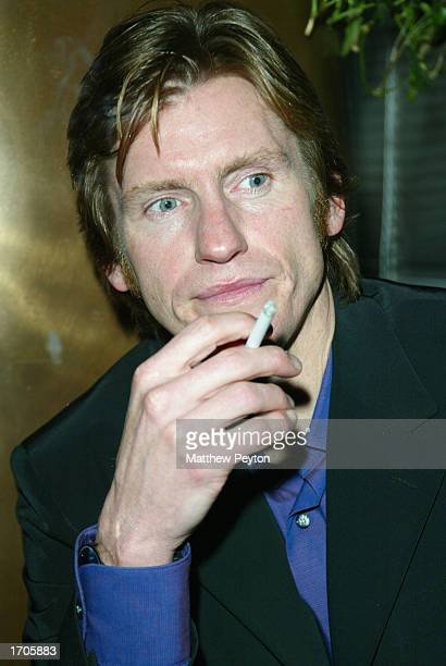 Actor Denis Leary enjoys a cigarette at the Natalie Portman/Britney Spears hosted New Year's Eve Party at the Hudson Hotel on December 31 2002 in New...