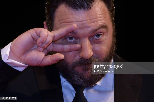 Actor Denis Menochet attends the premiere of the movie 'Jusqu'à la Garde' presented in competition at the 74th Venice Film Festival on September 8...