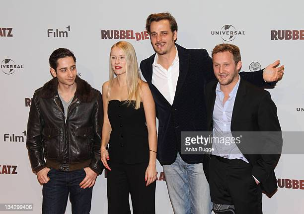 Actor Denis Moschitto actress Susanne Bormann Actor Max von Thun and actor Maximilian Brueckner attend the 'RUBBELDIEKATZ' Premiere at Cinemaxx on...