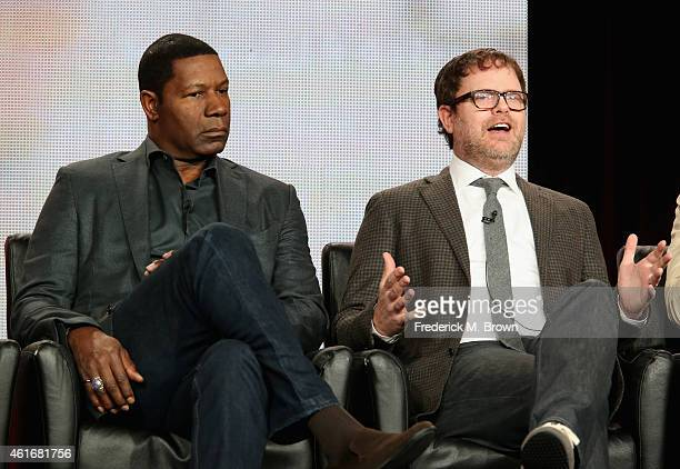 Actor Dennis Haysbert and actor/producer Rainn Wilson speak onstage during the 'Backstrom' panel discussion at the FOX portion of the 2015 Winter TCA...