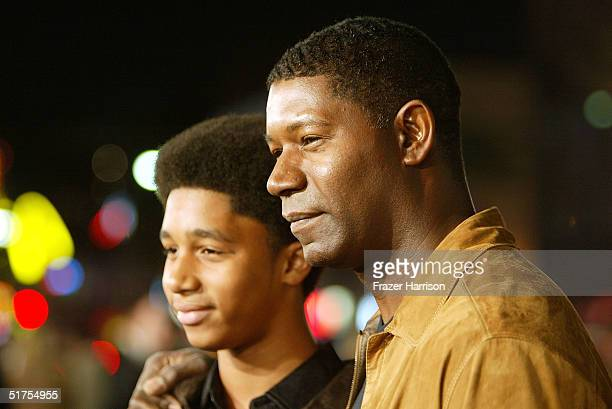 Actor Dennis Haysbert and son Charles Haysbert arrive at the premiere of Alexander at Grauman's Chinese Theater on November 16 2004 in Hollywood...