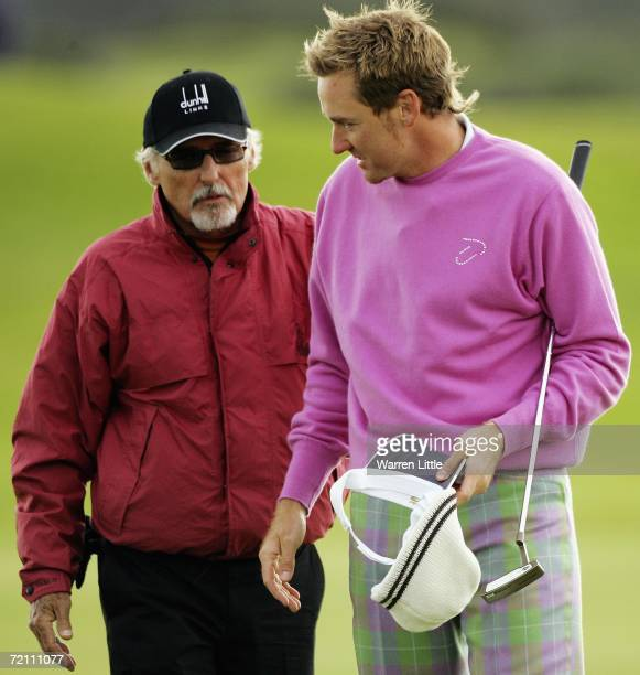 Actor Dennis Hopper and Ian Poulter of England on the 18th hole green during the Third Round of The Alfred Dunhill Links Championship at Carnoustie...