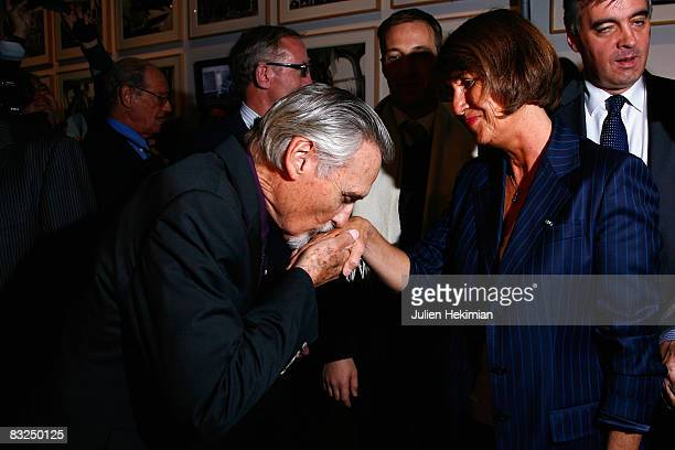 Actor Dennis Hopper kisses the hand of French Culture minister Christine Albanel at the opening of the Dennis Hopper art exhibit and film festival at...