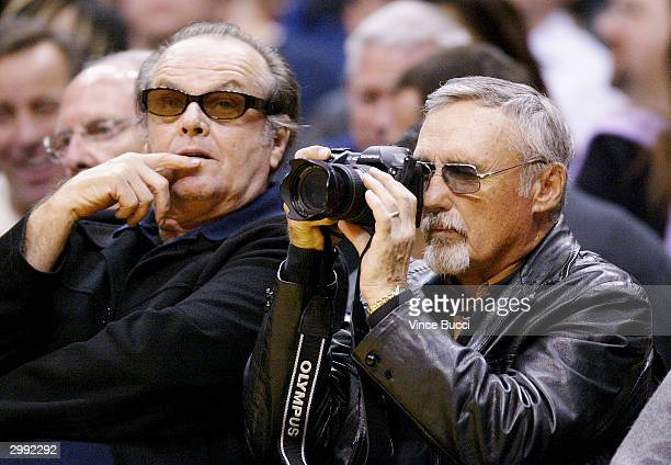 Actor Dennis Hopper snaps a photo next to his friend actor Jack Nicholson at the game between the Los Angeles Lakers and the Portland Trailblazers on...