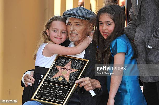 Actor Dennis Hopper who was honored with the 2403rd Star on the Hollywood Walk of Fame poses with his family daughter Galen Grier Hopper and...