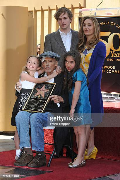 Actor Dennis Hopper who was honored with the 2403rd Star on the Hollywood Walk of Fame poses with his family daughter Galen Grier Hopper son Henry...