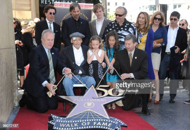 Actor Dennis Hopperwho was honored with the 2403rd Star on the Hollywood Walk of Fame pictured with City Councilman Tom LeBonge producer Mark Canton...