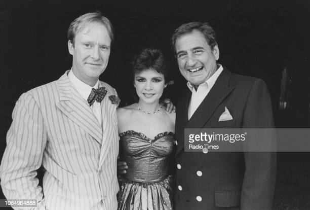 Actor Dennis Waterman singer Dana and comedian Bernie Winters photographed for Radio Times in connection with the television show 'Summertime...