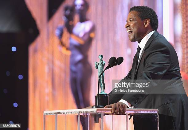 Actor Denzel Washington accepts the award for A Male Actor in a Leading Role onstage during The 23rd Annual Screen Actors Guild Awards at The Shrine...
