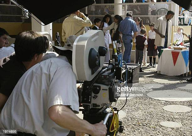 Actor Denzel Washington and actress Dakota Fanning film a scene of Man On Fire at a sports club May 5 2003 in Mexico City Mexico