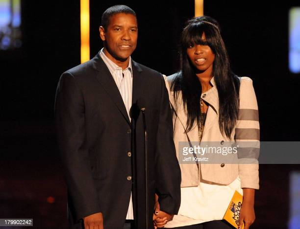 Actor Denzel Washington and daughter Olivia Washington onstage during the 2009 MTV Movie Awards held at the Gibson Amphitheatre on May 31 2009 in...
