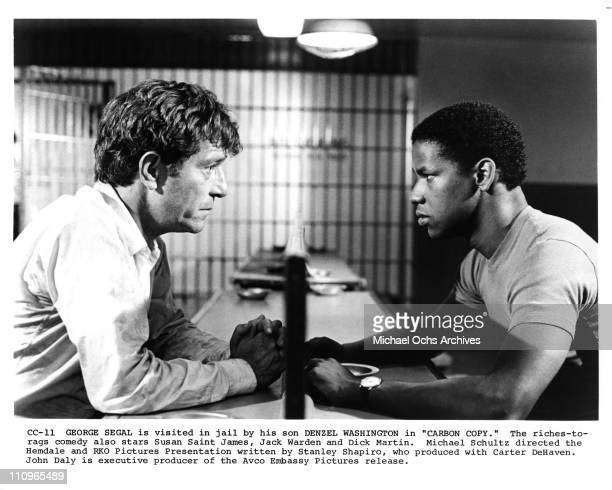 Actor Denzel Washington and George Segal in a scene for the feature film 'Carbon Copy' produced by Hemdale and RKO in 1981 in Los Angeles, California.