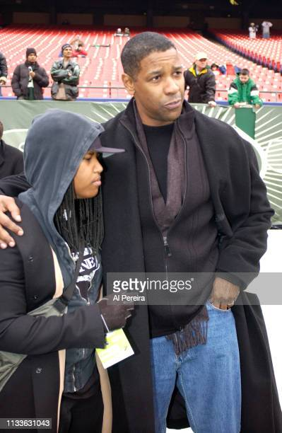 Actor Denzel Washington and his daughter Katia follow the action on the New York Jets sideline when he attends the New York Jets v Seattle Seahawks...