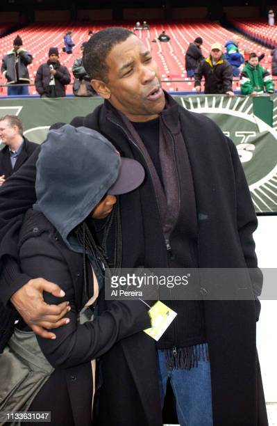 Actor Denzel Washington and his daughter, Katia, follow the action on the New York Jets sideline when he attends the New York Jets v Seattle Seahawks...