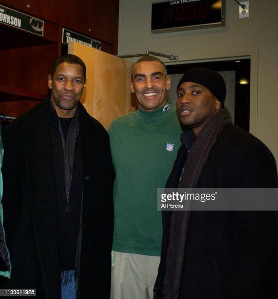 Actor Denzel Washington and his son John David Washington meet with New York Jets Head Coach Herm Edwards in the locker room when he attends the New...