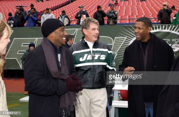 Actor Denzel Washington and his son John David Washington meet with New York Jets Special Teams Coordinator Mike Westhoff on the New York Jets...