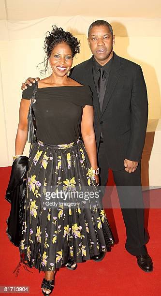 Actor Denzel Washington and his wife Pauletta arrive at the dinner in honour of Nelson Mandela celebrating his 90th birthday at Hyde Park on June 25...