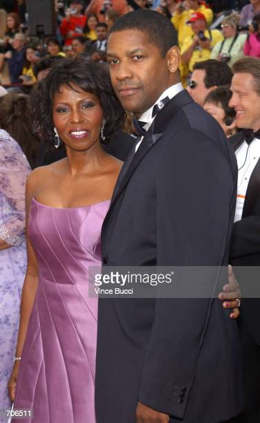 Actor Denzel Washington and his wife Pauletta Pearson arrive at the 74th Annual Academy Awards March 24 2002 at The Kodak Theater in Hollywood CA