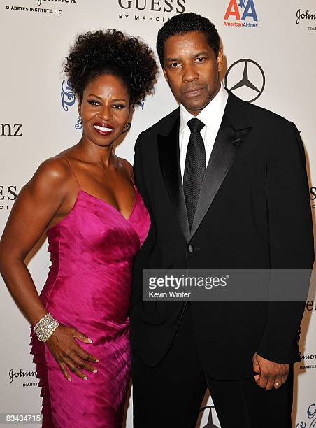 Actor Denzel Washington and his wife Pauletta Washington pose during the cocktail reception at the 30th anniversary Carousel of Hope Ball to benefit...