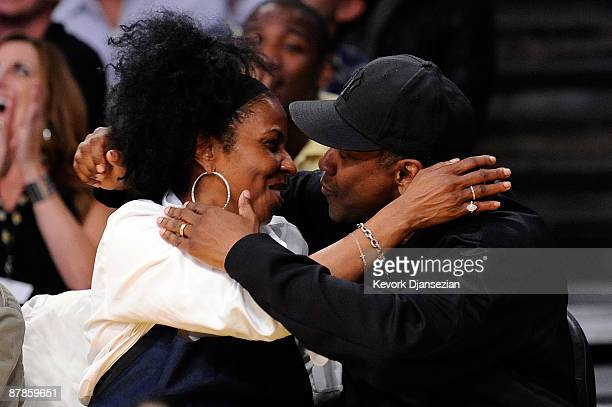 Actor Denzel Washington and wife Pauletta Pearson kiss for the 'Kiss Cam' during Game One of the Western Conference Finals during the 2009 NBA...