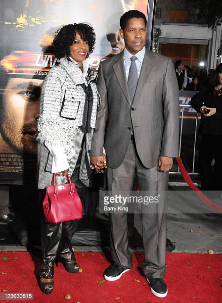 Actor Denzel Washington and wife Pauletta Washington arrive at the Los Angeles Premiere Unstoppable at Regency Village Theatre on October 26 2010 in...