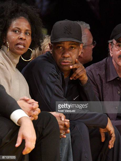 Actor Denzel Washington and wife Pauletta Washington attend Game Five of the Western Conference Semifinals during the 2009 NBA Playoffs at Staples...
