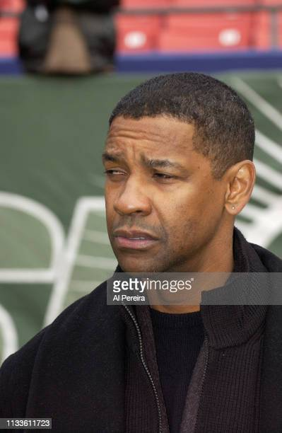 Actor Denzel Washington follows the action from the New York Jets sideline when he attends the New York Jets v Seattle Seahawks game at the...
