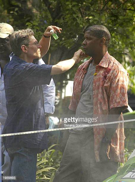 Actor Denzel Washington has makeup applied to his face prior to filming a scene from the film Man On Fire while on location at Condesa Park April 29...