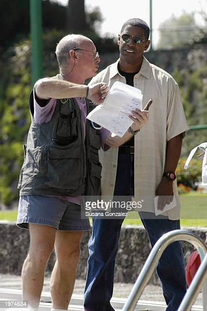 Actor Denzel Washington listens to director Tony Scott while filming a scene of Man On Fire at a sports club May 5 2003 in Mexico City Mexico