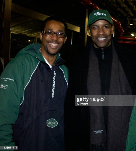 Actor Denzel Washington meets with New York Jets alumni player Bobby Jackson in the locker room when he attends the New York Jets v Seattle Seahawks...