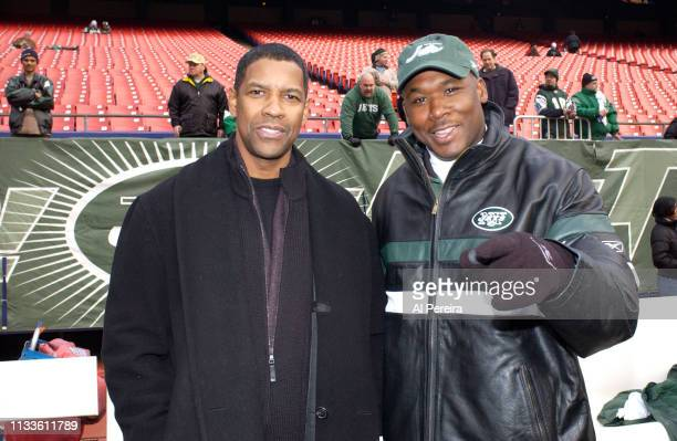 Actor Denzel Washington meets with New York Jets Defensive Backs Coach Backs Corwin Brown on the New York Jets sideline when he attends the New York...