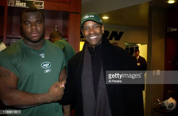 Actor Denzel Washington meets with New York Jets Defensive Tackle Dewayne Robertson in the locker room when he attends the New York Jets v Seattle...