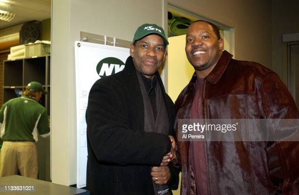 Actor Denzel Washington meets with New York Jets Defensive Tackle Josh Evans in the New York Jets locker room when he attends the New York Jets v...