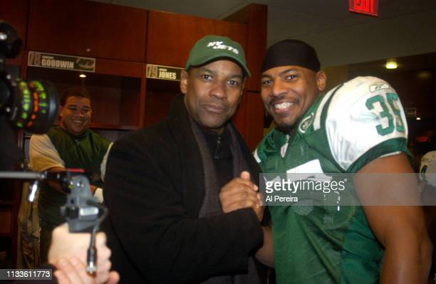 Actor Denzel Washington meets with New York Jets fullback B.J. Askew in the locker room when he attends the New York Jets v Seattle Seahawks game at...