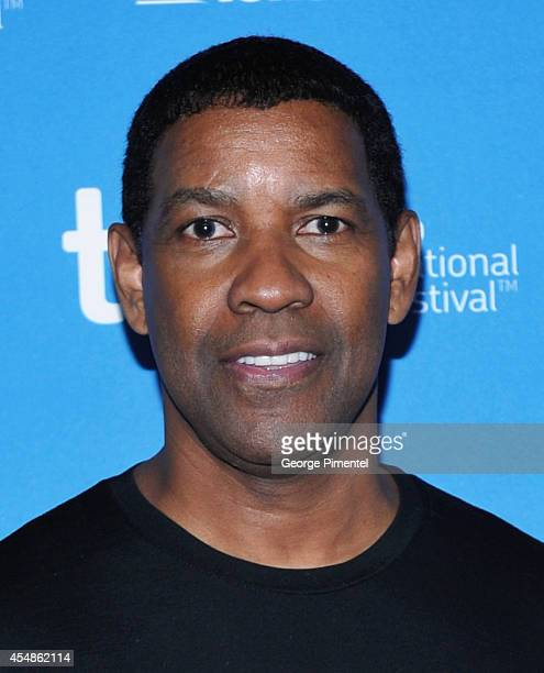 "Actor Denzel Washington poses at ""The Equalizer"" Press Conference during the 2014 Toronto International Film Festival at TIFF Bell Lightbox on..."