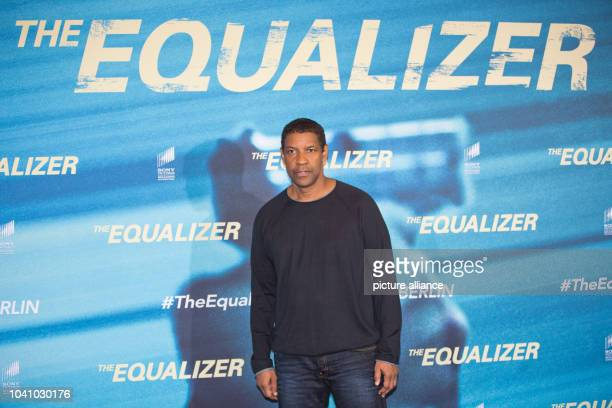 "Actor Denzel Washington poses during the presentation of the film ""The Equalizer"" in Berlin, Germany, 16 September 2014. The film will come to German..."
